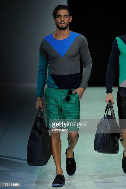 A model walks the runway at the Emporio Armani Spring Summer 2014 fashion show during Milan Menswear Fashion Week on June 24 2013 in Milan Italy