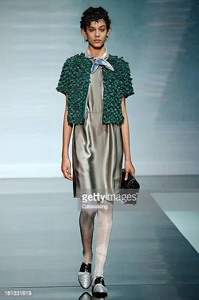 A model walks the runway at the Emporio Armani Spring Summer 2014 fashion show during Milan Fashion Week on September 20 2013 in Milan Italy