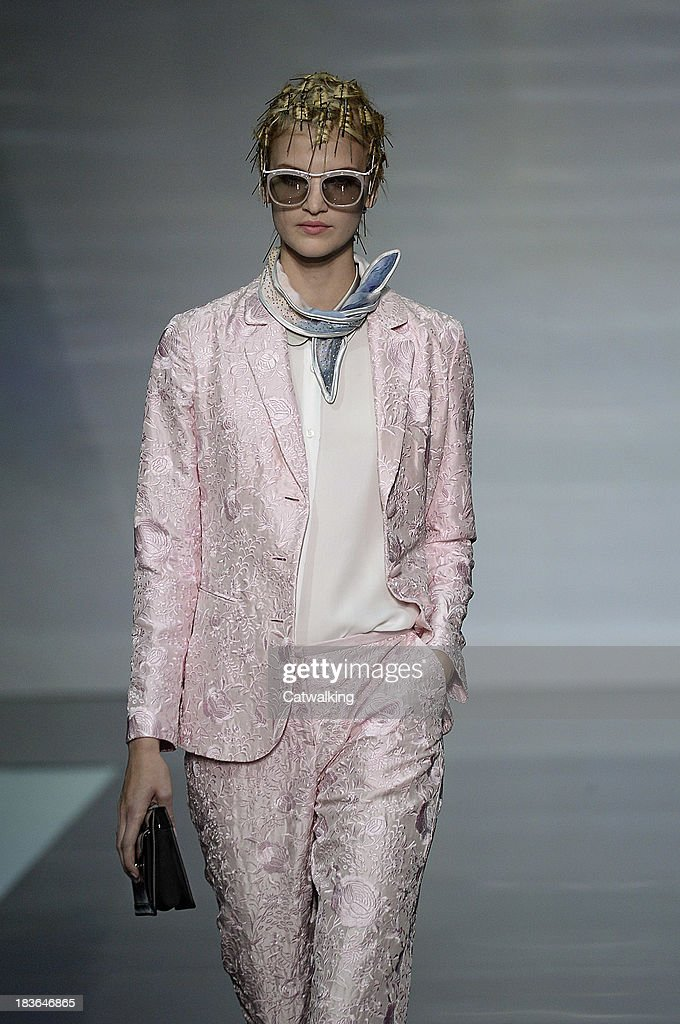 A model walks the runway at the Emporio Armani Spring Summer 2014 fashion show during Milan Fashion Week on September 20, 2013 in Milan, Italy.