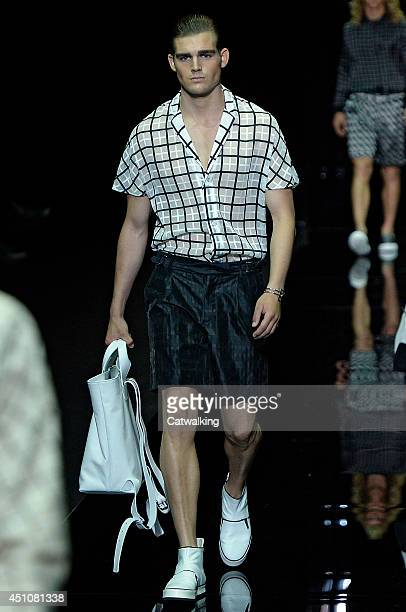 A model walks the runway at the Emporio Armani Spring Summer 2015 fashion show during Milan Menswear Fashion Week on June 23 2014 in Milan Italy