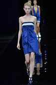 A model walks the runway at the Emporio Armani Spring Summer 2015 fashion show during Milan Fashion Week on September 18 2014 in Milan Italy