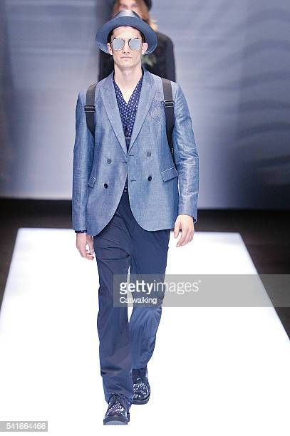 A model walks the runway at the Emporio Armani Spring Summer 2017 fashion show during Milan Menswear Fashion Week on June 20 2016 in Milan Italy