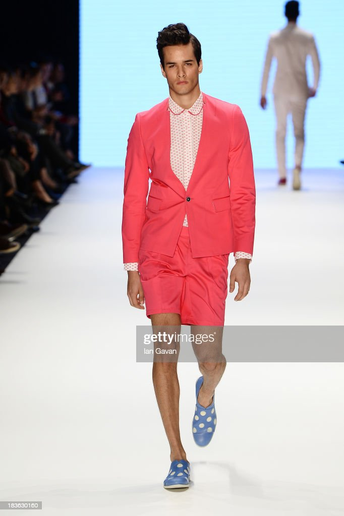 A model walks the runway at the Emre Erdemoglu show during Mercedes-Benz Fashion Week Istanbul s/s 2014 presented by American Express on October 8, 2013 in Istanbul, Turkey.