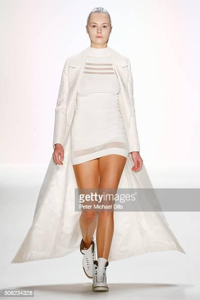 A model walks the runway at the Emre Erdemoglu show during the MercedesBenz Fashion Week Berlin Autumn/Winter 2016 at Brandenburg Gate on January 22...