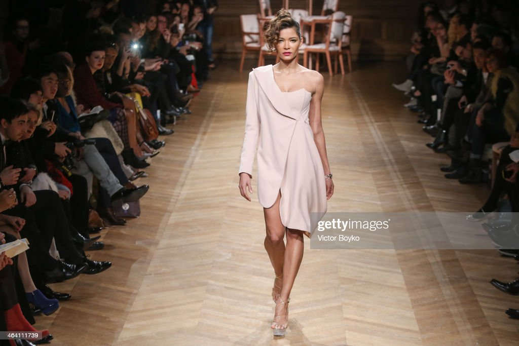 A model walks the runway at the Eric Tilausch show during Paris Fashion Week - Haute Couture S/S 2014 on January 20, 2014 in Paris, France.