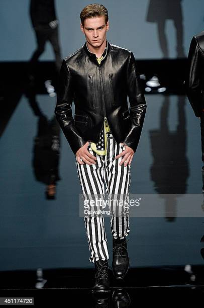 A model walks the runway at the Ermanno Scervino Spring Summer 2015 fashion show during Milan Menswear Fashion Week on June 24 2014 in Milan Italy
