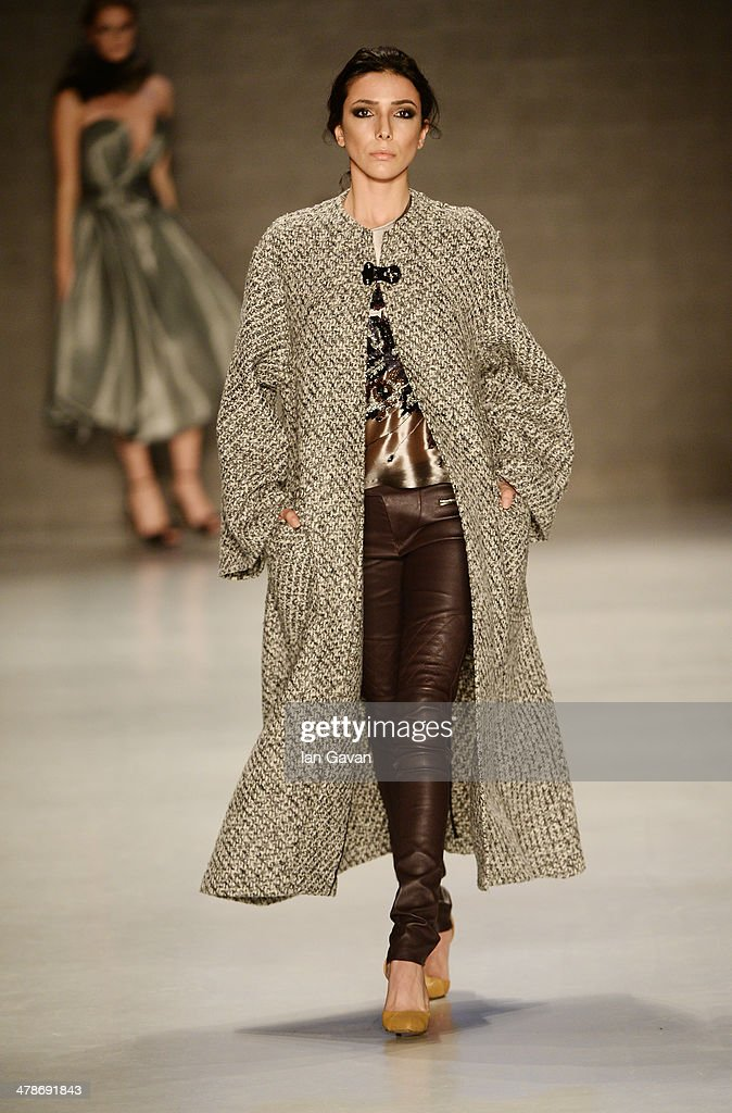 A model walks the runway at the Erol Albayrak show during MBFWI presented by American Express Fall/Winter 2014 on March 14, 2014 in Istanbul, Turkey.