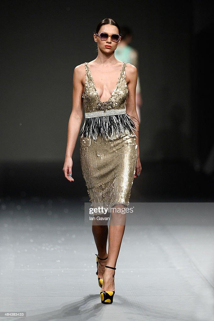 A model walks the runway at the Essa show during Fashion Forward at Madinat Jumeirah on April 12, 2014 in Dubai, United Arab Emirates.