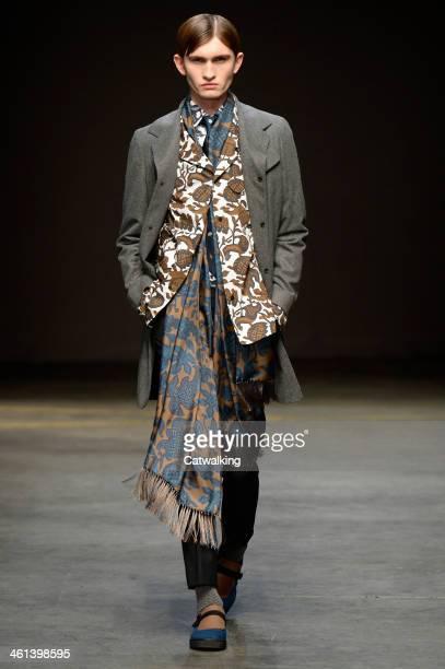 A model walks the runway at the ETautz Autumn Winter 2014 fashion show during London Menswear Fashion Week on January 8 2014 in London United Kingdom
