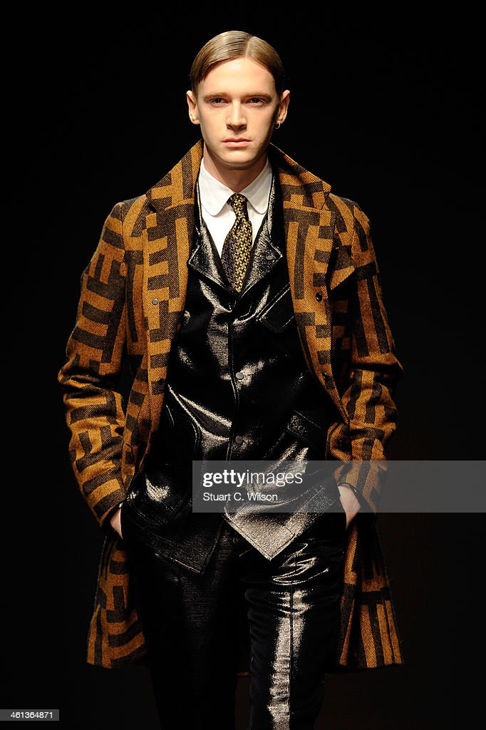 A model walks the runway at the E.Tautz show during The London Collections: Men Autumn/Winter 2014 on January 8, 2014 in London, England.