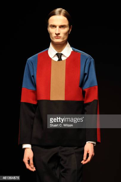 A model walks the runway at the ETautz show during The London Collections Men Autumn/Winter 2014 on January 8 2014 in London England