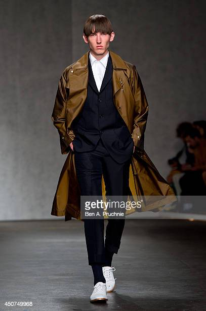 A model walks the runway at the ETautz show during the London Collections Men SS15 on June 17 2014 in London England