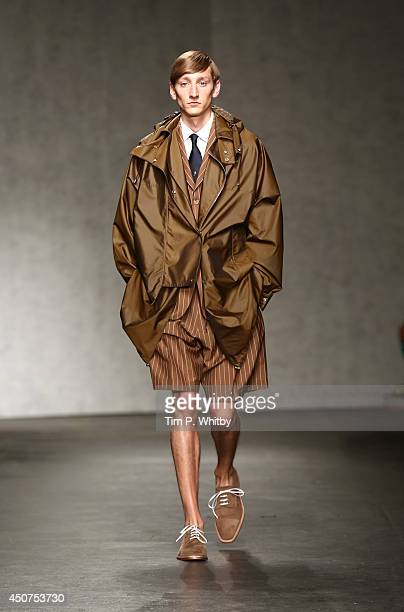 A model walks the runway at the ETautz show during the London Collections Men SS15 at the Old Sorting Office on June 17 2014 in London England