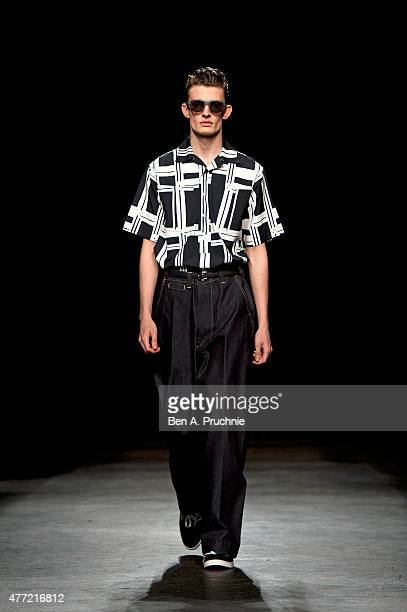 A model walks the runway at the ETautz show during The London Collections Men SS16 at The Old Sorting Office on June 15 2015 in London England