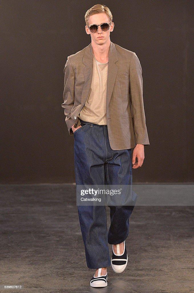 A model walks the runway at the ETautz Spring Summer 2017 fashion show during London Menswear Fashion Week on June 11 2016 in London United Kingdom