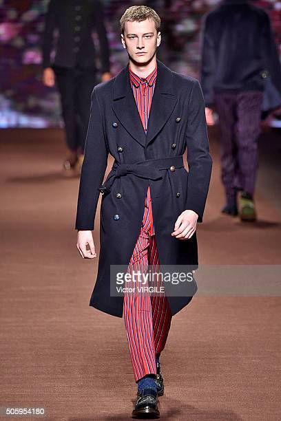 A model walks the runway at the Etro show during Milan Men's Fashion Week Fall/Winter 2016/17 on January 18 2016 in Milan Italy