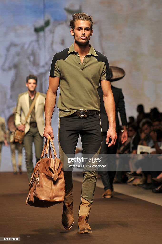 A model walks the runway at the Etro show during Milan Menswear Fashion Week Spring Summer 2014 show on June 24, 2013 in Milan, Italy.