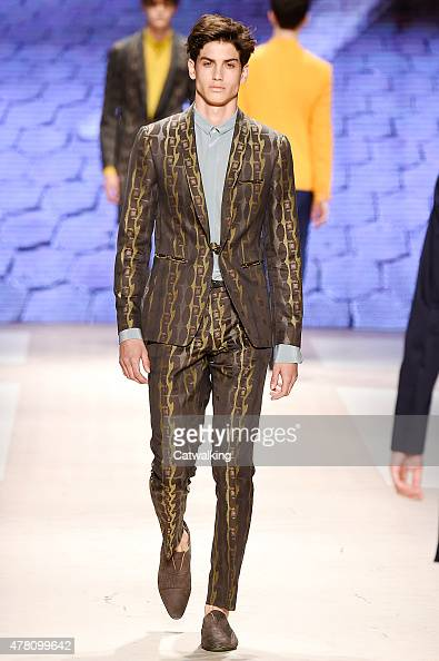 A model walks the runway at the Etro Spring Summer 2016 fashion show during Milan Menswear Fashion Week on June 22 2015 in Milan Italy