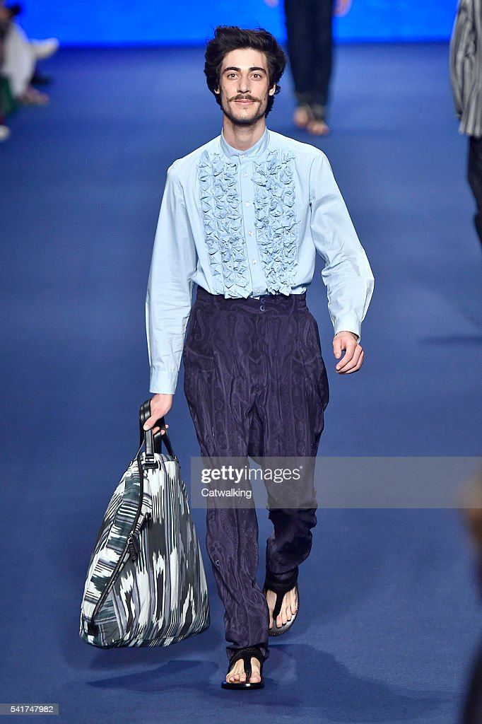 A model walks the runway at the Etro Spring Summer 2017 fashion show during Milan Menswear Fashion Week on June 20 2016 in Milan Italy