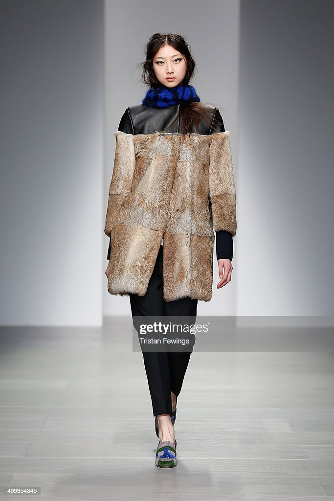 A model walks the runway at the Eudon Choi show at London Fashion Week AW14 at Somerset House on February 14, 2014 in London, England.
