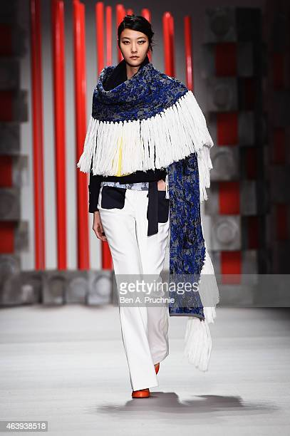A model walks the runway at the Eudon Choi show during London Fashion Week Fall/Winter 2015/16 at Somerset House on February 20 2015 in London England