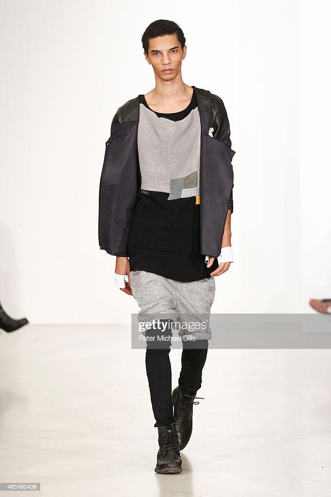 A model walks the runway at the European Fashion Award FASH 2014 at Brandenburger Gate on January 13, 2014 in Berlin, Germany.