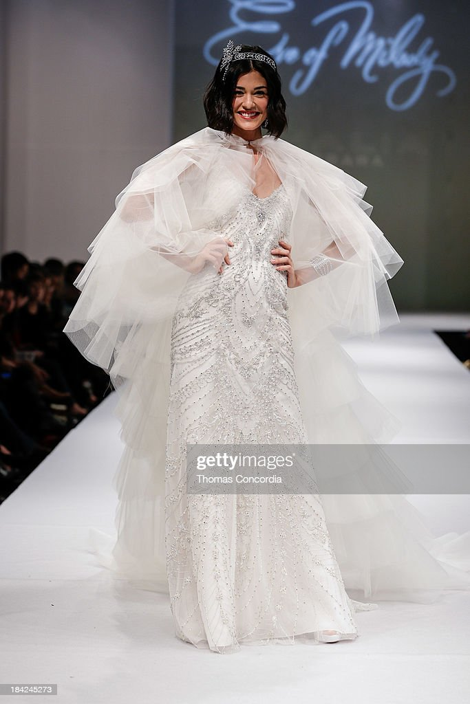 A model walks the runway at the Eve Of Milady Fall 2014 Bridal collection show at Pier 94 on October 12, 2013 in New York City.