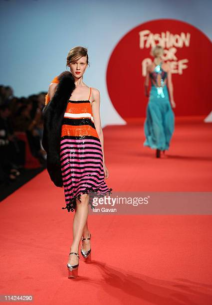 A model walks the runway at the Fashion For Relief at Forville market during the 64th Annual Cannes Film Festival on May 16 2011 in Cannes France