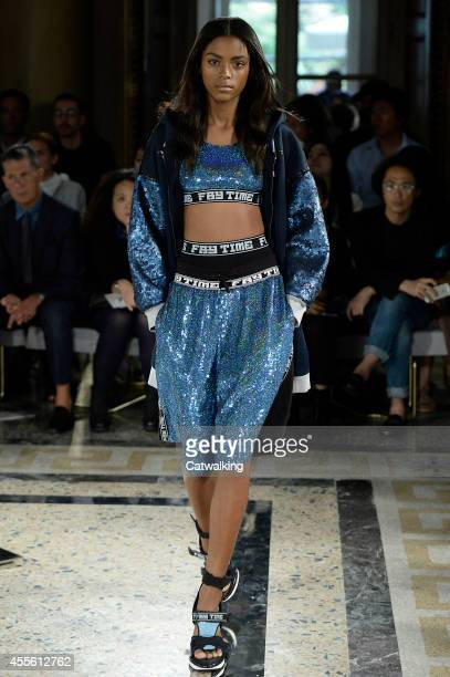 A model walks the runway at the Fay Spring Summer 2015 fashion show during Milan Fashion Week on September 17 2014 in Milan Italy