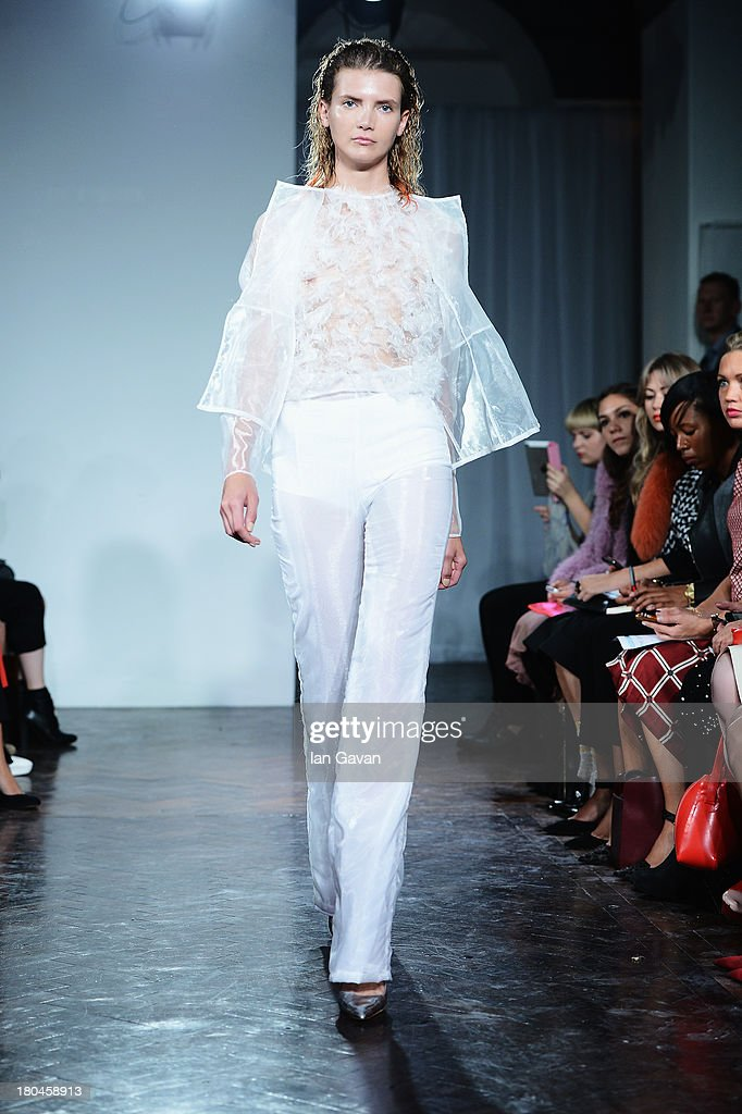 A model walks the runway at the Felder Felder show during London Fashion Week SS14 at The Studio, Somerset House on September 13, 2013 in London, England.