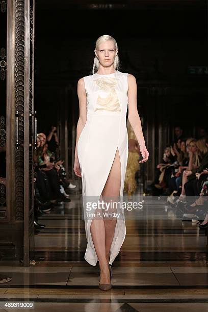 A model walks the runway at the FelderFelder show at London Fashion Week AW14 at Freemasons Hall on February 14 2014 in London England