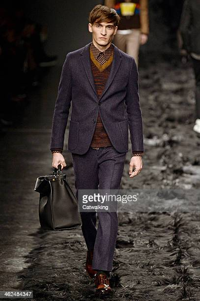 A model walks the runway at the Fendi Autumn Winter 2014 fashion show during Milan Menswear Fashion Week on January 13 2014 in Milan Italy