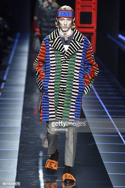 A model walks the runway at the Fendi Autumn Winter 2017 fashion show during Milan Menswear Fashion Week on January 16 2017 in Milan Italy