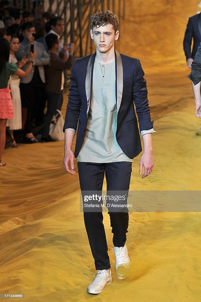 A model walks the runway at the Fendi show during Milan Menswear Fashion Week Spring Summer 2014 show on June 24 2013 in Milan Italy