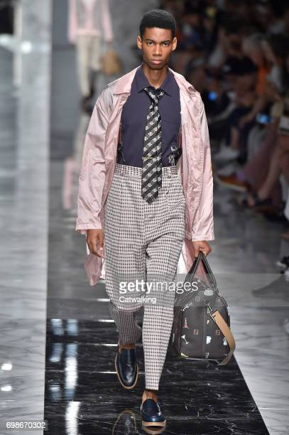 A model walks the runway at the Fendi Spring Summer 2018 fashion show during Milan Menswear Fashion Week on June 19 2017 in Milan Italy