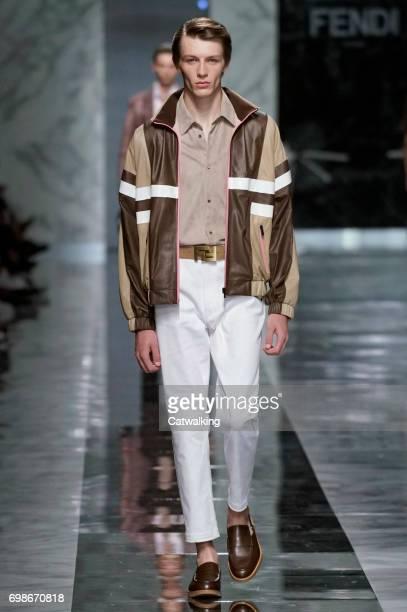 A model walks the runway at the Fendi Spring Summer 2018 fashion show during Milan Menswear Fashion Week on June 19 2017 in Milan Italy