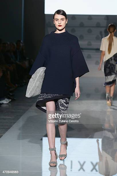 A model walks the runway at the ffiXXed show during the International Woolmark Prize as part of Milan Fashion Week Womenswear Autumn/Winter 2014 on...