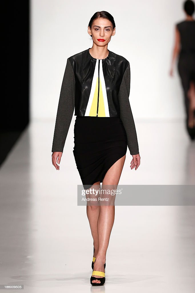 A model walks the runway at the Final of DHL Young Designers Contest during Mercedes-Benz Fashion Week Russia S/S 2014 on October 27, 2013 in Moscow, Russia.