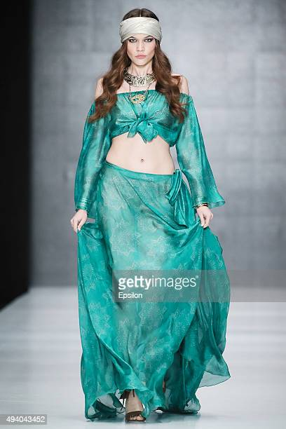 A model walks the runway at the FISICO during day 3 of Mercedes Benz Fashion Week Russia SS16 at Manege on October 23 2015 in Moscow Russia