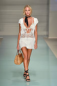 A model walks the runway at the For Love And Lemons 2017 Collection At Funkshion Swim Fashion Week at Collins Park on July 17 2016 in Miami Beach...