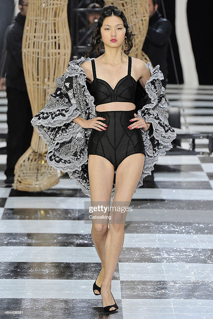 A model walks the runway at the Frank Sorbier Spring Summer 2014 fashion show during Paris Haute Couture Fashion Week on January 22, 2014 in Paris, France.