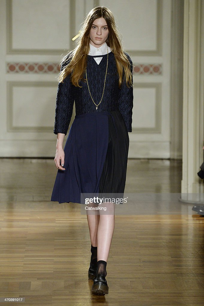 A model walks the runway at the Frankie Morello Autumn Winter 2014 fashion show during Milan Fashion Week on February 19, 2014 in Milan, Italy.