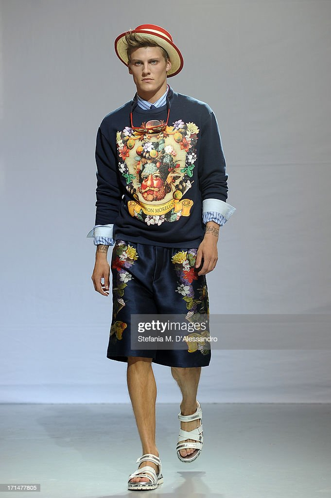 A model walks the runway at the Frankie Morello show during Milan Menswear Fashion Week Spring Summer 2014 on June 25, 2013 in Milan, Italy.