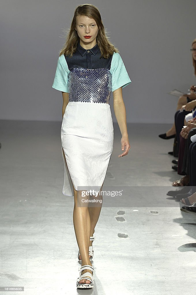 A model walks the runway at the Frankie Morello Spring Summer 2014 fashion show during Milan Fashion Week on September 23 2013 in Milan Italy