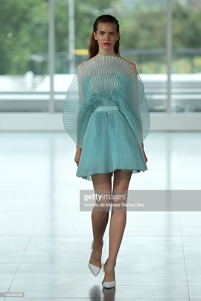 A model walks the runway at the Fyodor Golan show during London Fashion Week SS14 on September 13, 2013 in London, England.