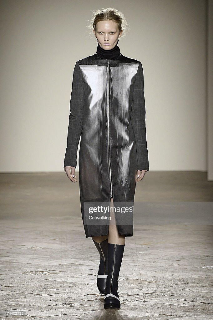 A model walks the runway at the Gabriele Colangelo Autumn Winter 2014 fashion show during Milan Fashion Week on February 22, 2014 in Milan, Italy.