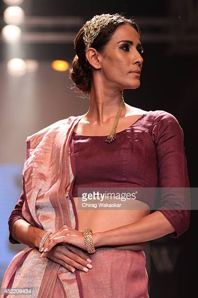 A model walks the runway at the Ganjam show during day 2 of the India International Jewellery Week 2014 at grand Hyatt on July 15 2014 in Mumbai India