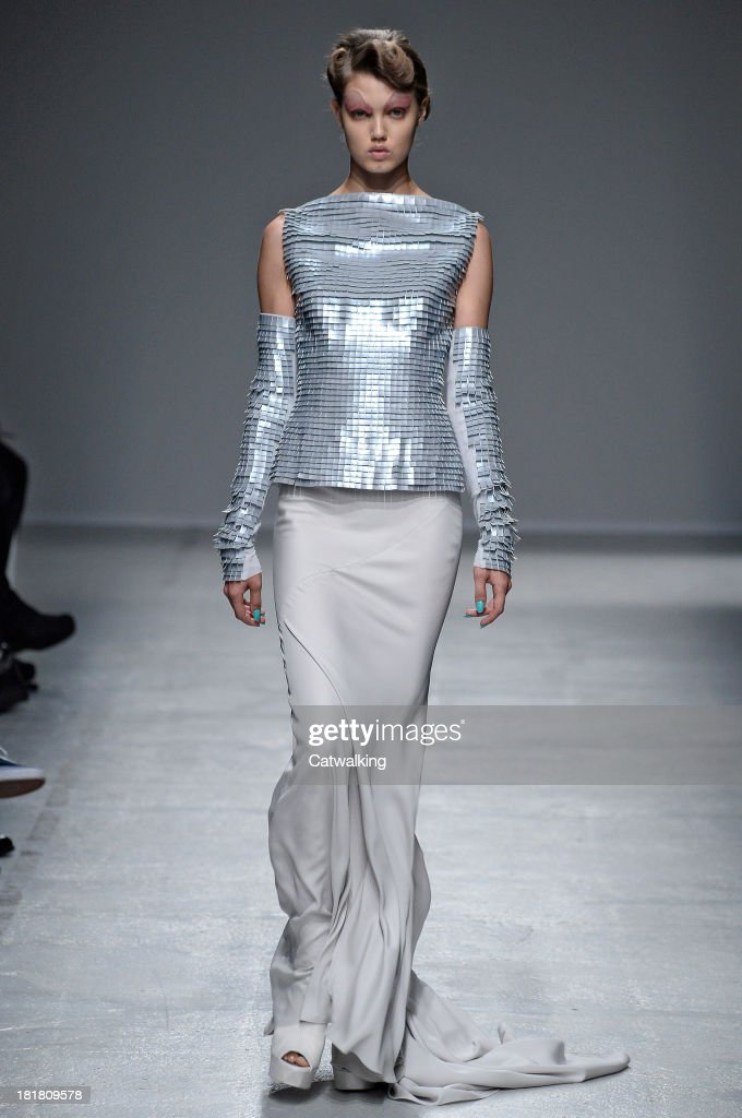 A model walks the runway at the Gareth Pugh Spring Summer 2014 fashion show during Paris Fashion Week on September 25, 2013 in Paris, France.