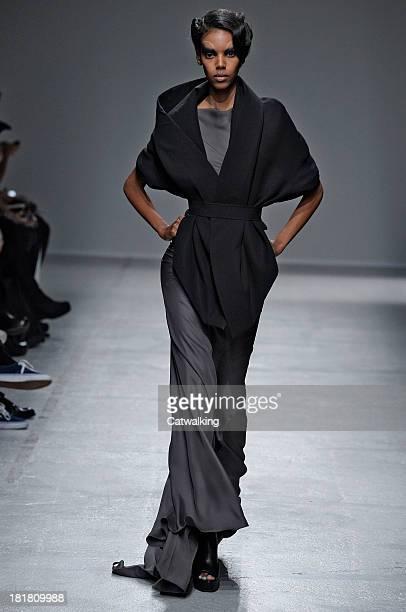 A model walks the runway at the Gareth Pugh Spring Summer 2014 fashion show during Paris Fashion Week on September 25 2013 in Paris France