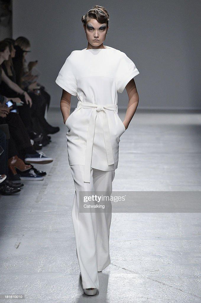 A model walks the runway at the Gareth Pugh Spring Summer 2014 fashion show during Paris Fashion Week on September 25, 2013 in Paris, France.